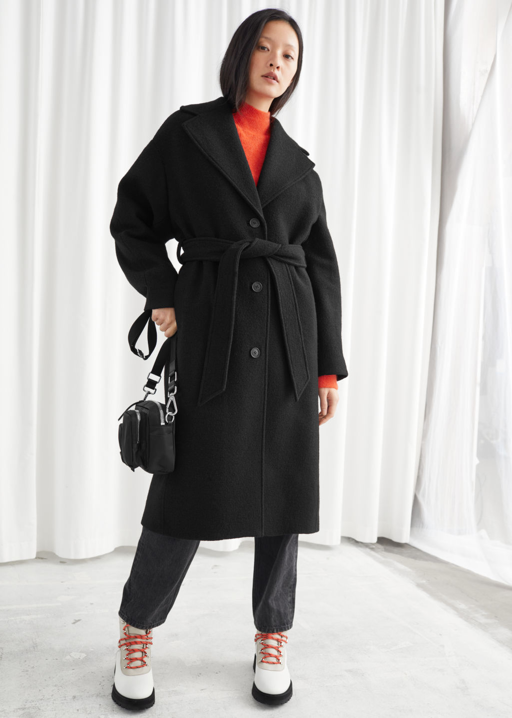 Model front image of Stories oversized belted wool coat in black