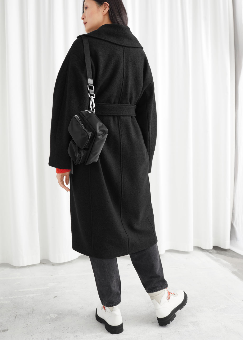 Model back image of Stories oversized belted wool coat in black