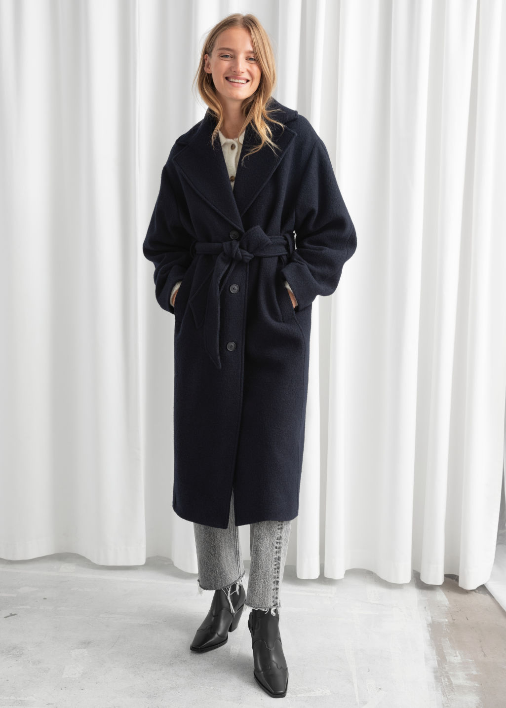 Model front image of Stories oversized belted wool coat in blue