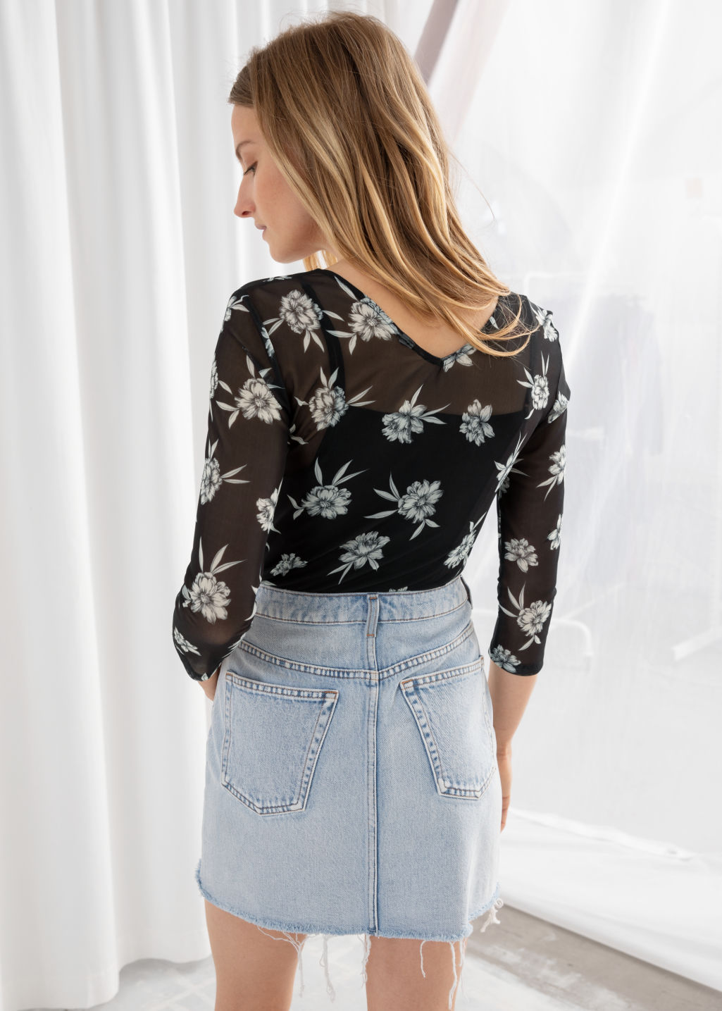 Model back image of Stories sheer floral ruched top in black