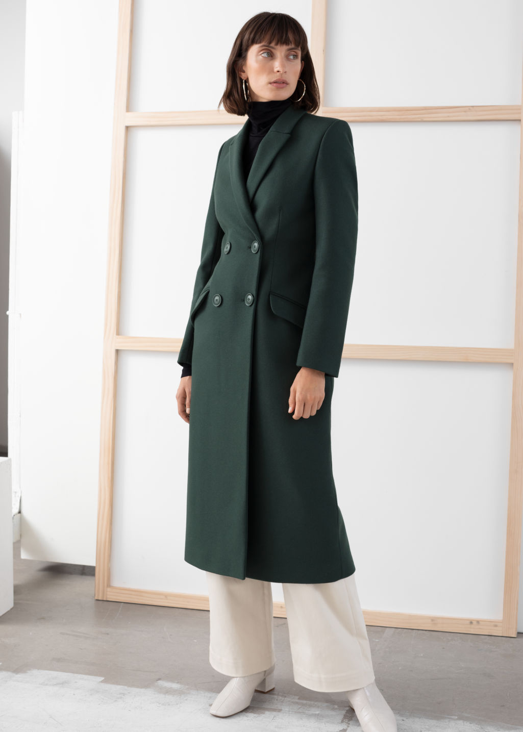 Model front image of Stories double breasted tailored coat in green