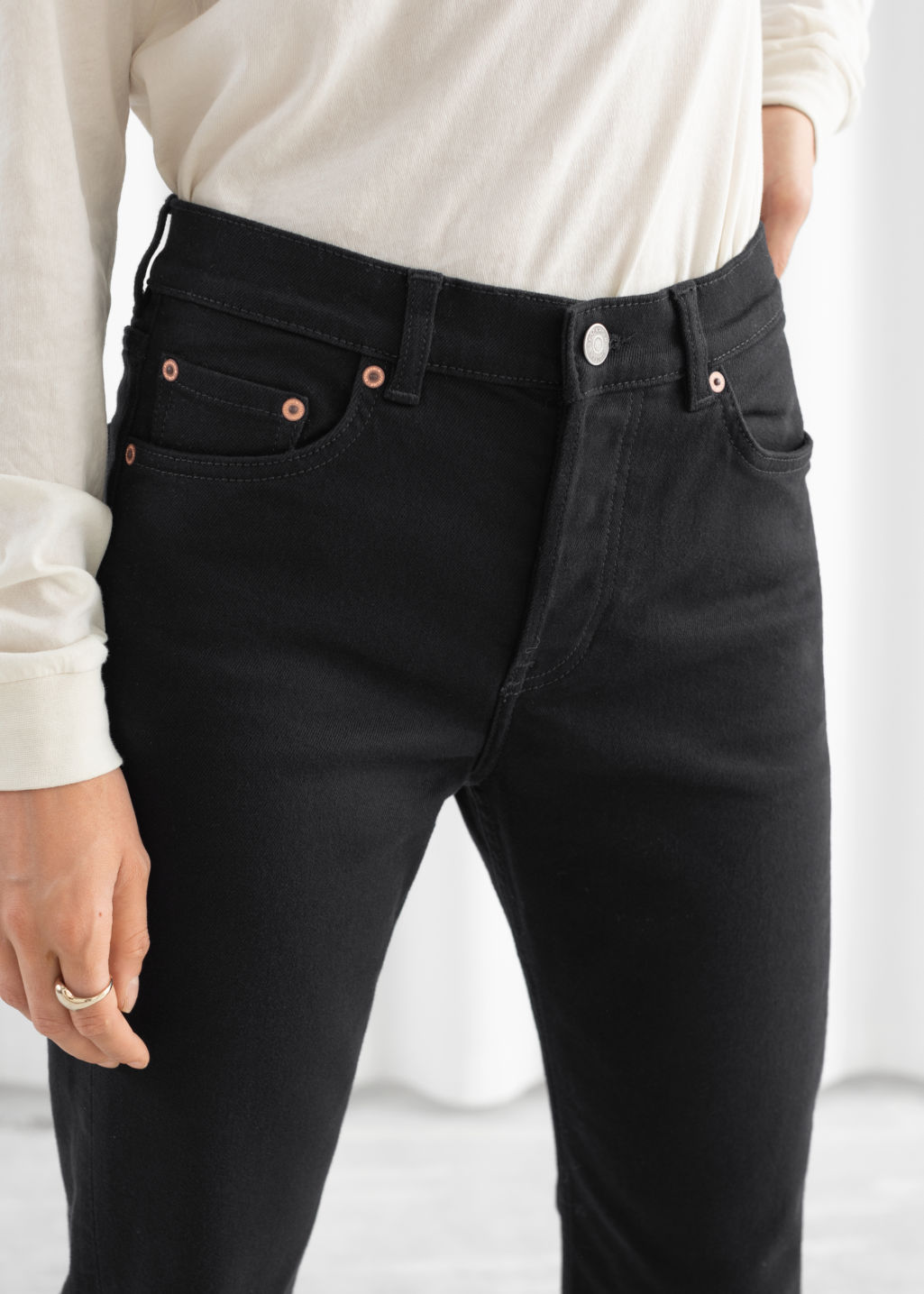 Model back image of Stories classic kick flare mid rise jeans in black