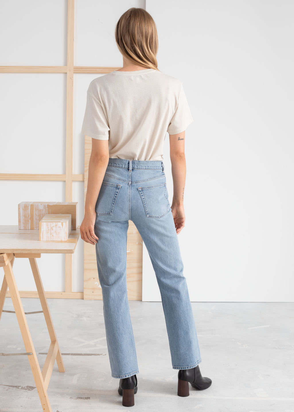 Model back image of Stories classic kick flare mid rise jeans in blue