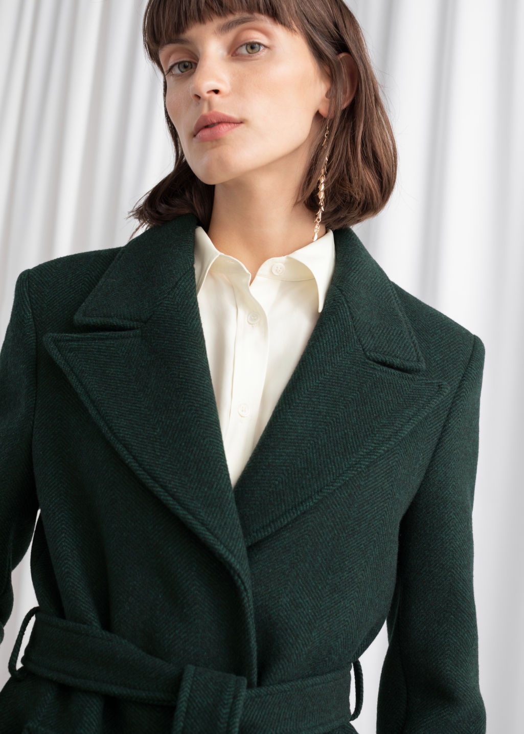 Model back image of Stories belted wool blend long coat in green