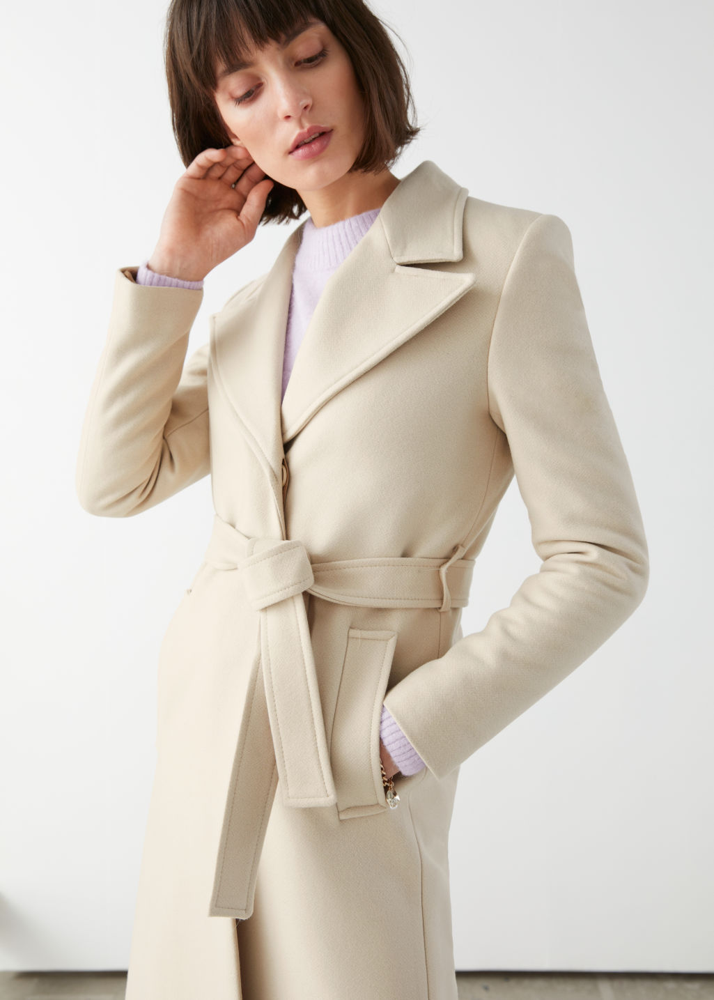 Model front image of Stories belted wool blend long coat in beige