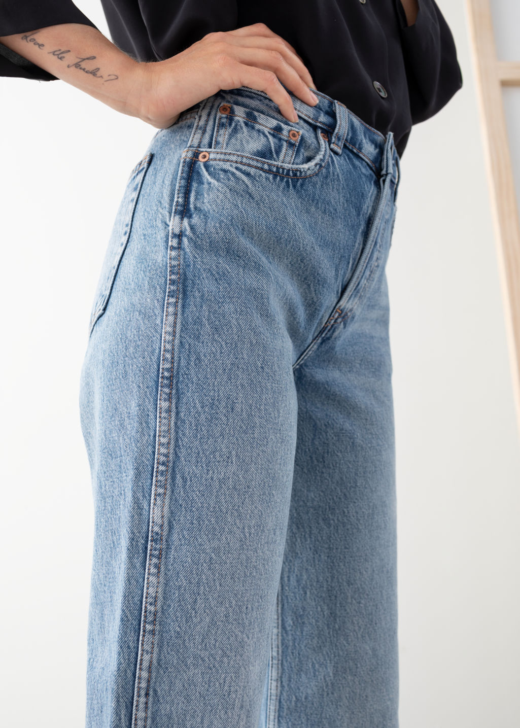 Model back image of Stories straight mid rise organic cotton jeans in blue