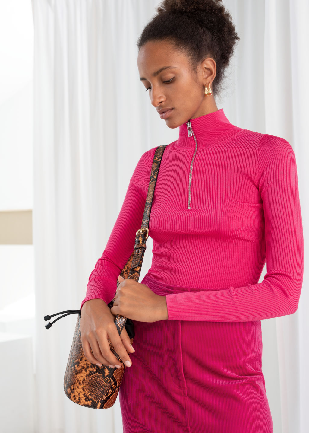 Model front image of Stories half zip ribbed knit turtleneck in pink