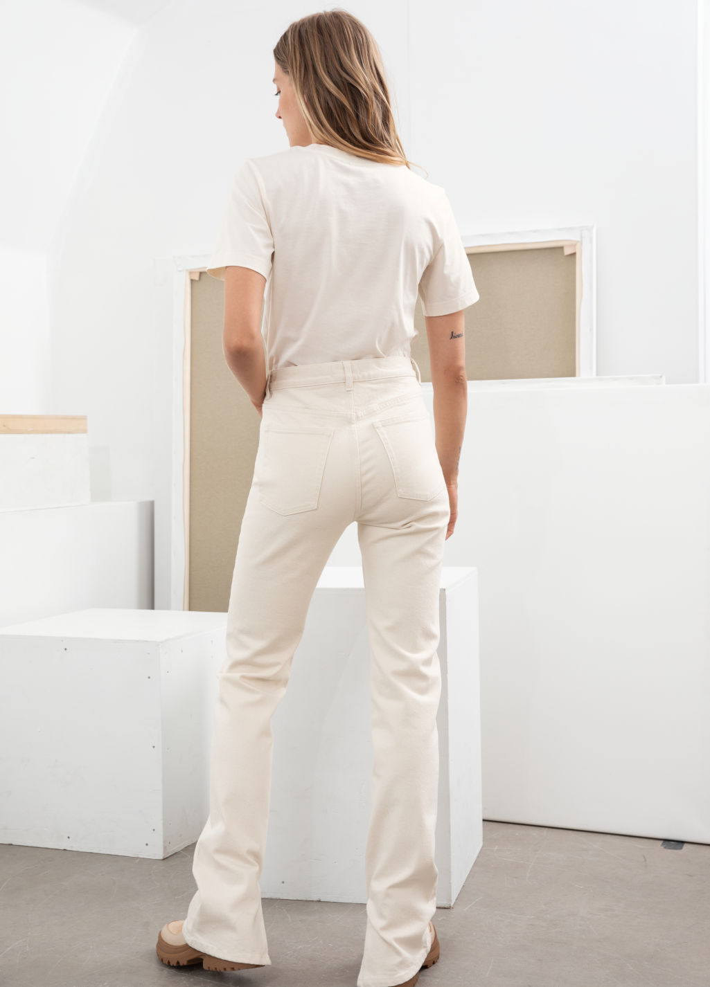 Model back image of Stories straight stretch long leg jeans in white