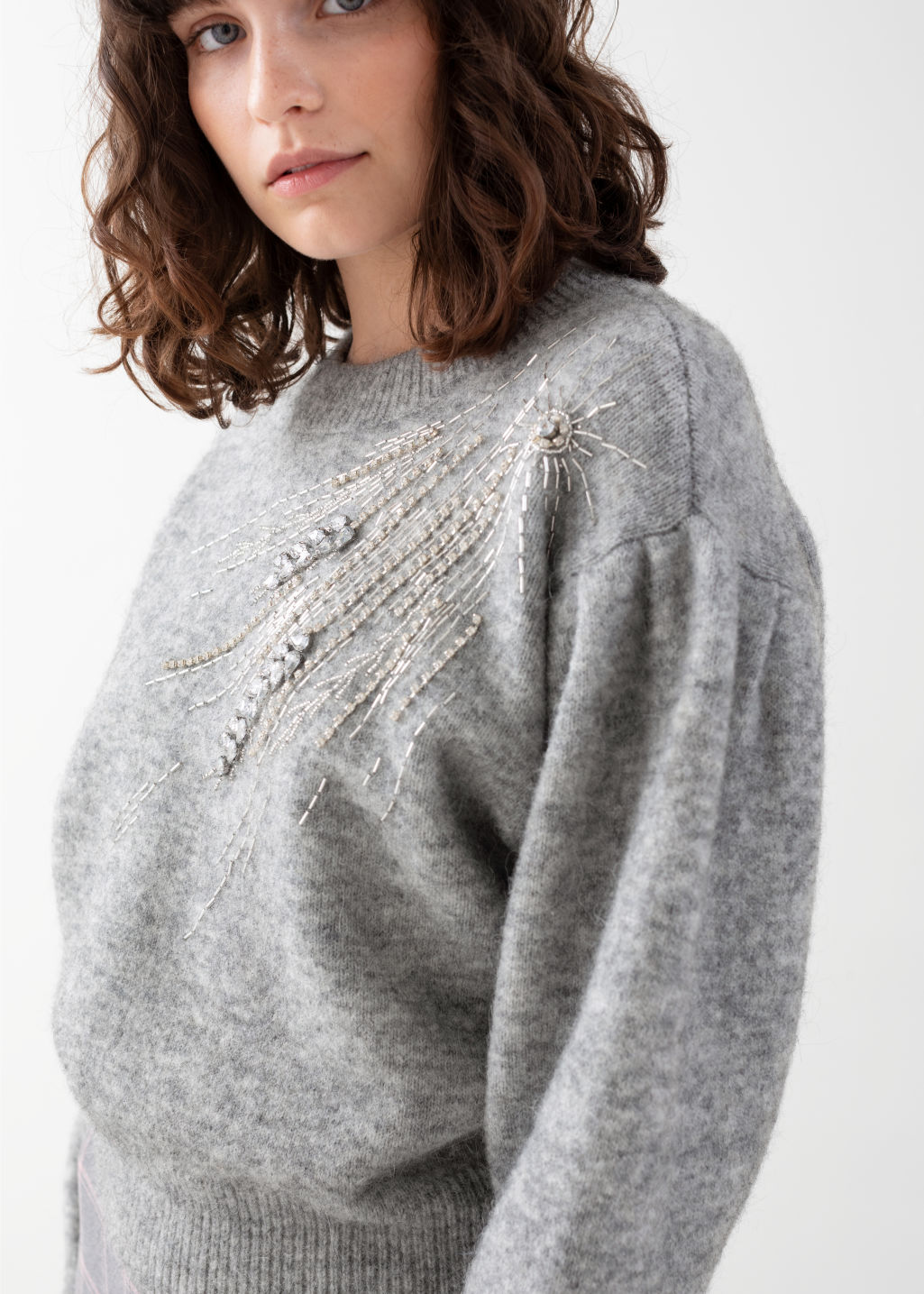 Model side image of Stories embellished wool blend sweater in grey
