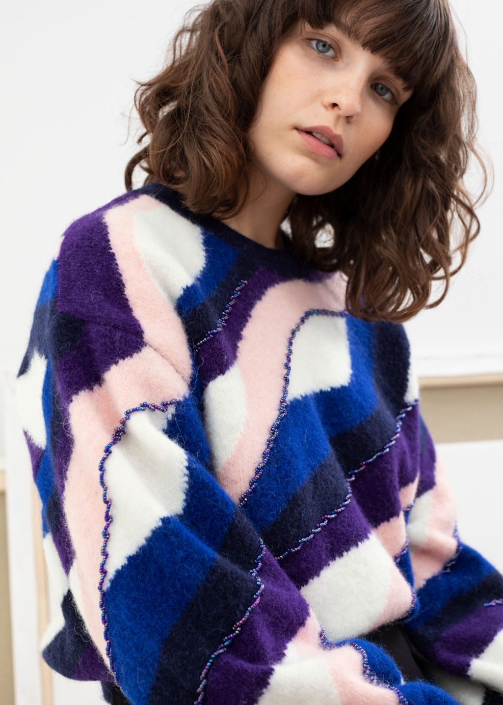 Model front image of Stories embellished colour wave sweater in purple