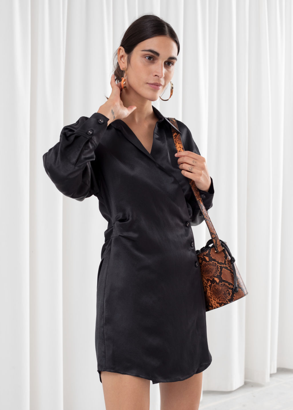 Model front image of Stories asymmetric mini shirt dress in black