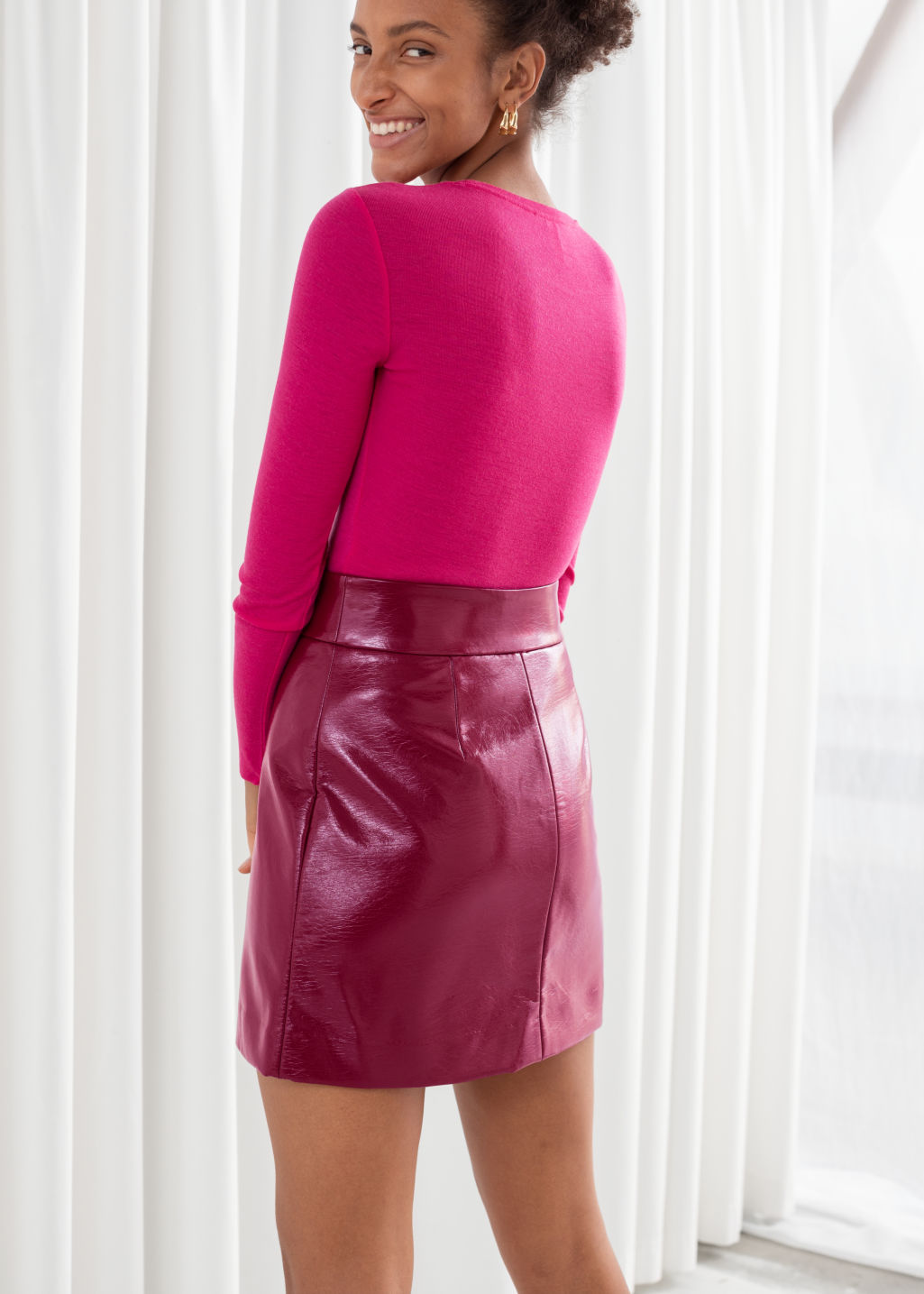 Model back image of Stories patent fitted mini skirt in pink
