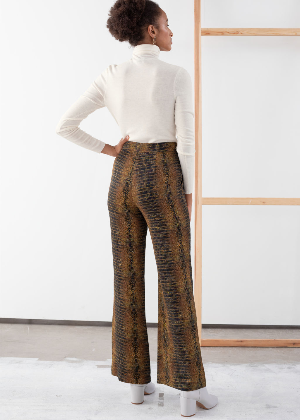 Model back image of Stories flowy tailored croco trousers in yellow