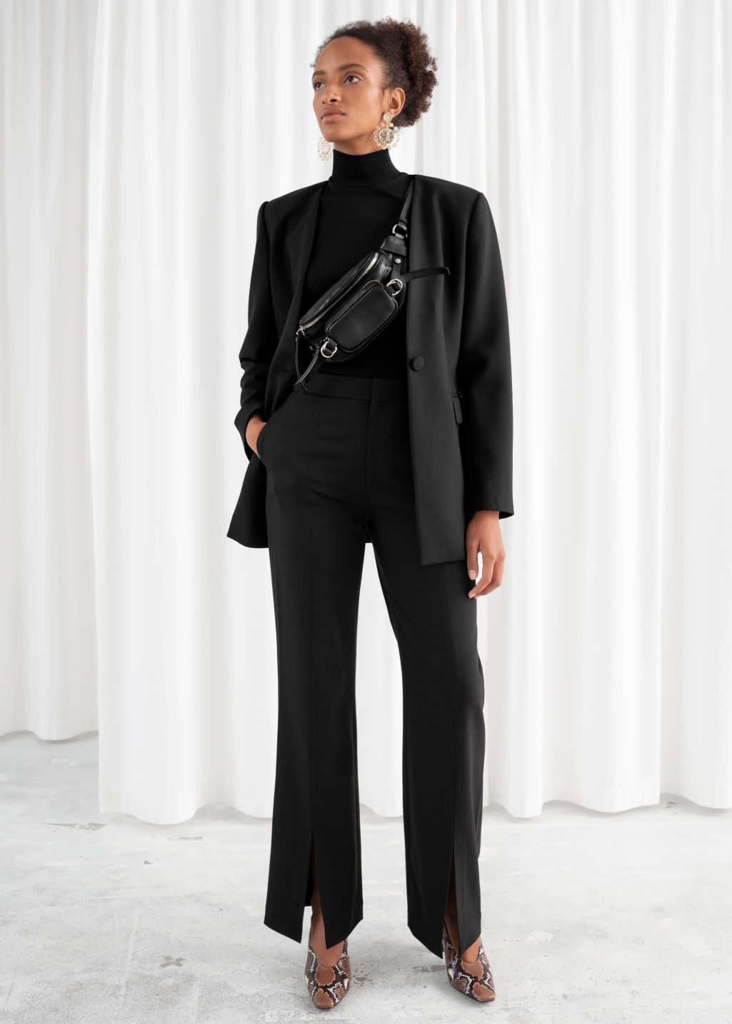 Model front image of Stories front split tailored trousers in black
