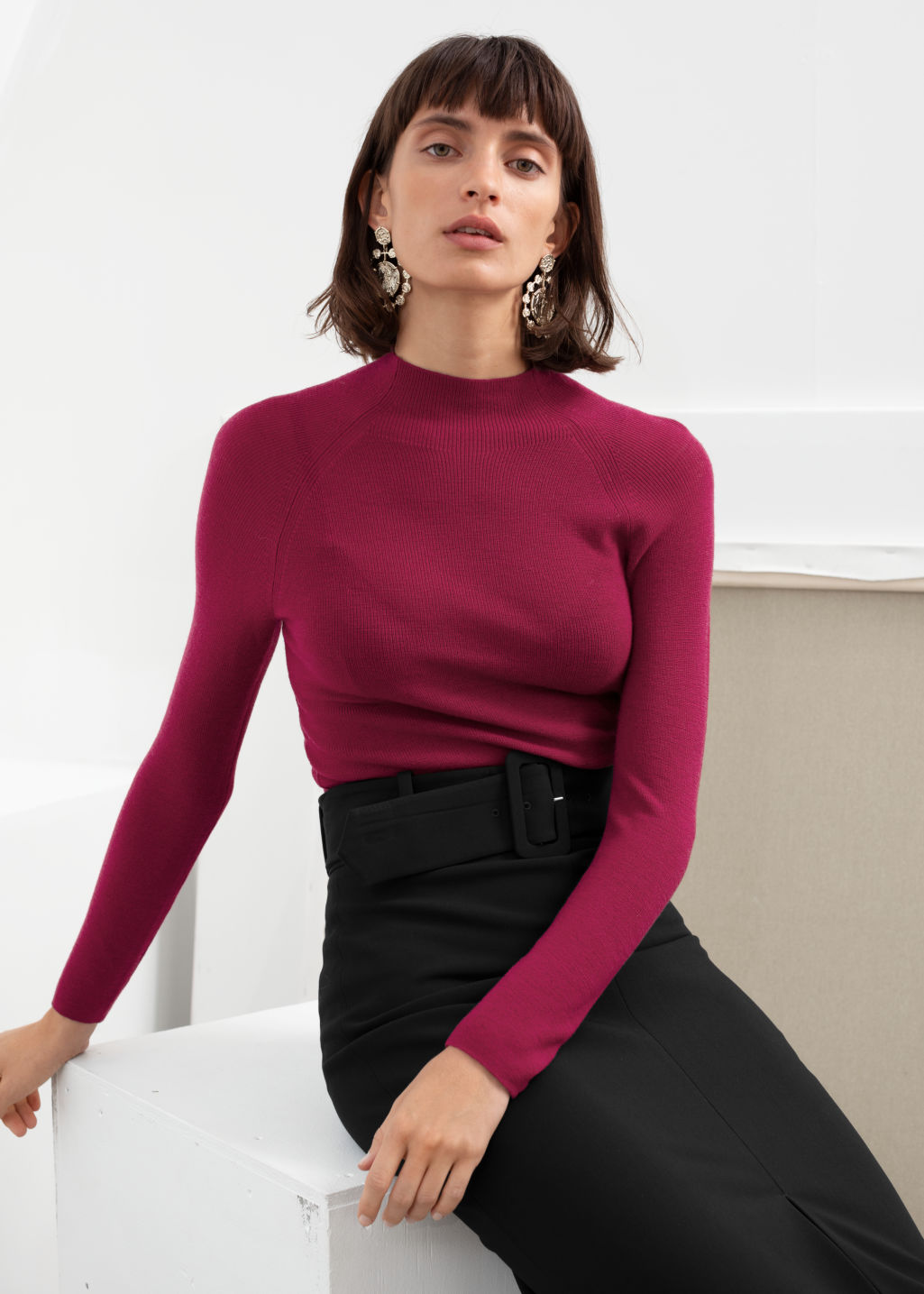 Model front image of Stories fitted mock neck wool sweater in pink