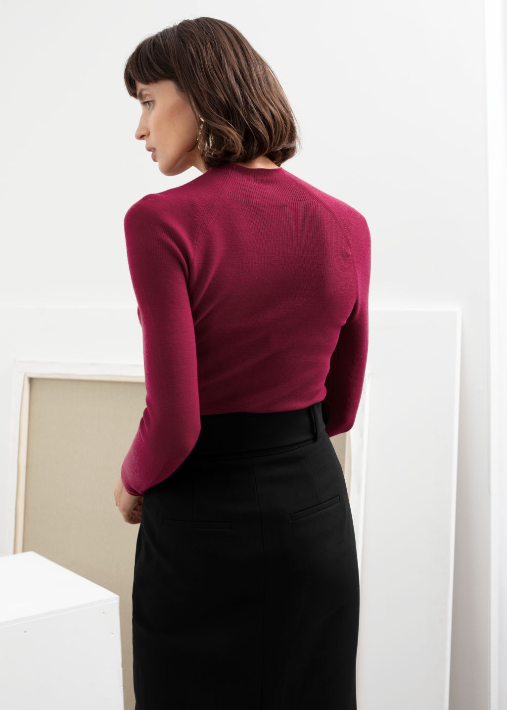 Model back image of Stories fitted mock neck wool sweater in pink