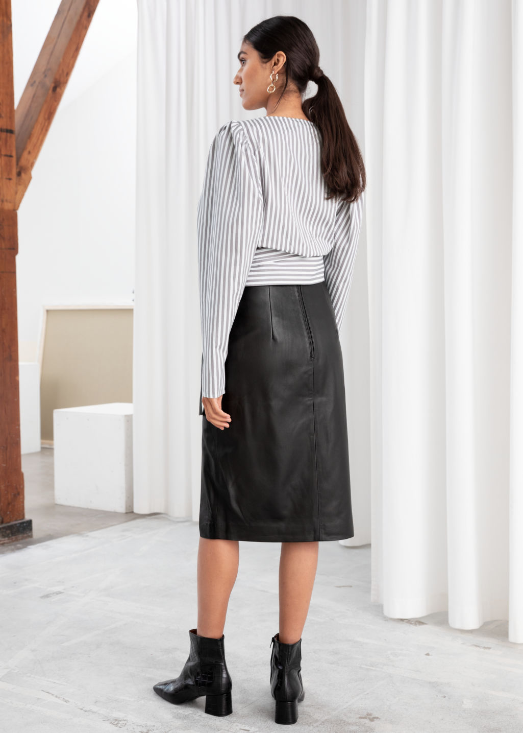 Model back image of Stories leather asymmetric pencil skirt in black