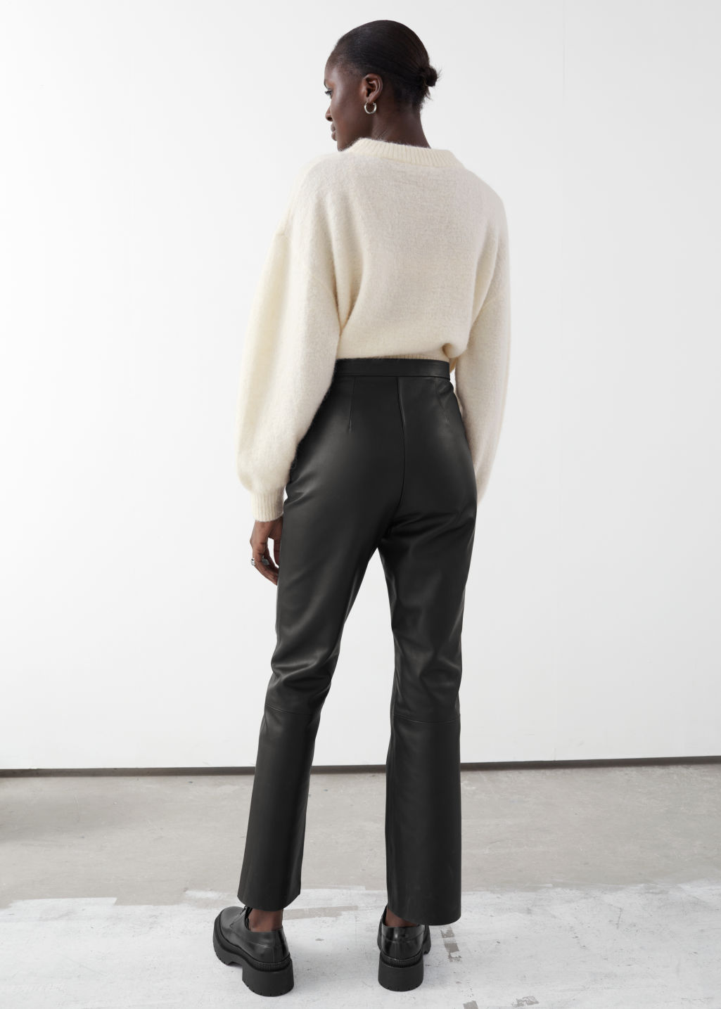 Model back image of Stories soft leather trousers in black