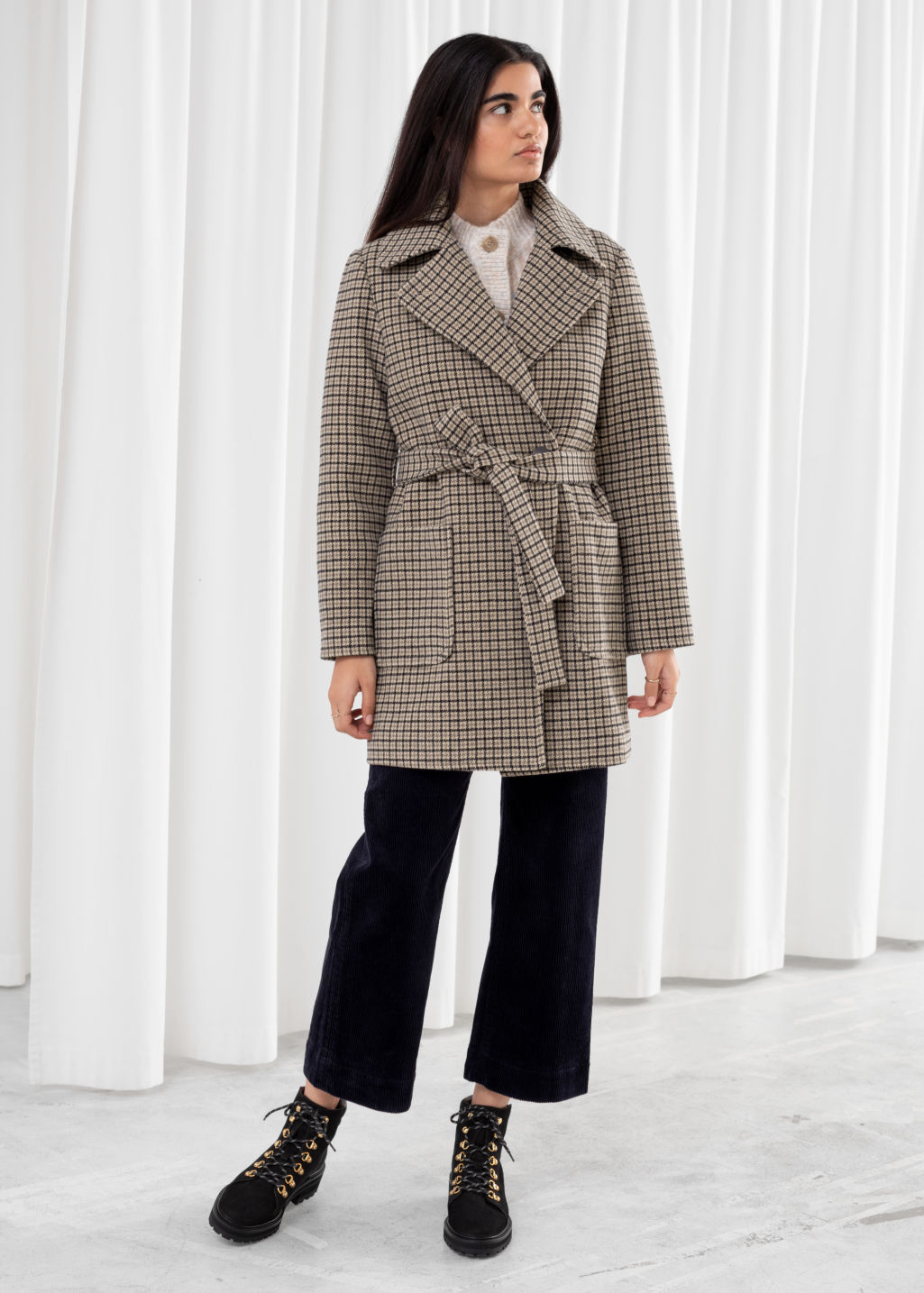 Model front image of Stories belted houndstooth wool blend coat in beige