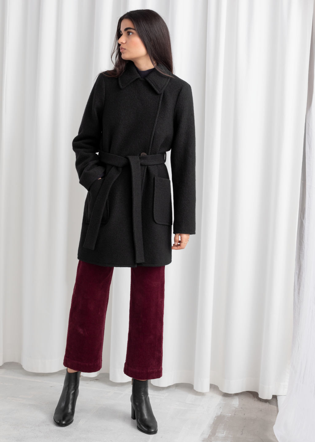 Model front image of Stories belted houndstooth wool blend coat in black