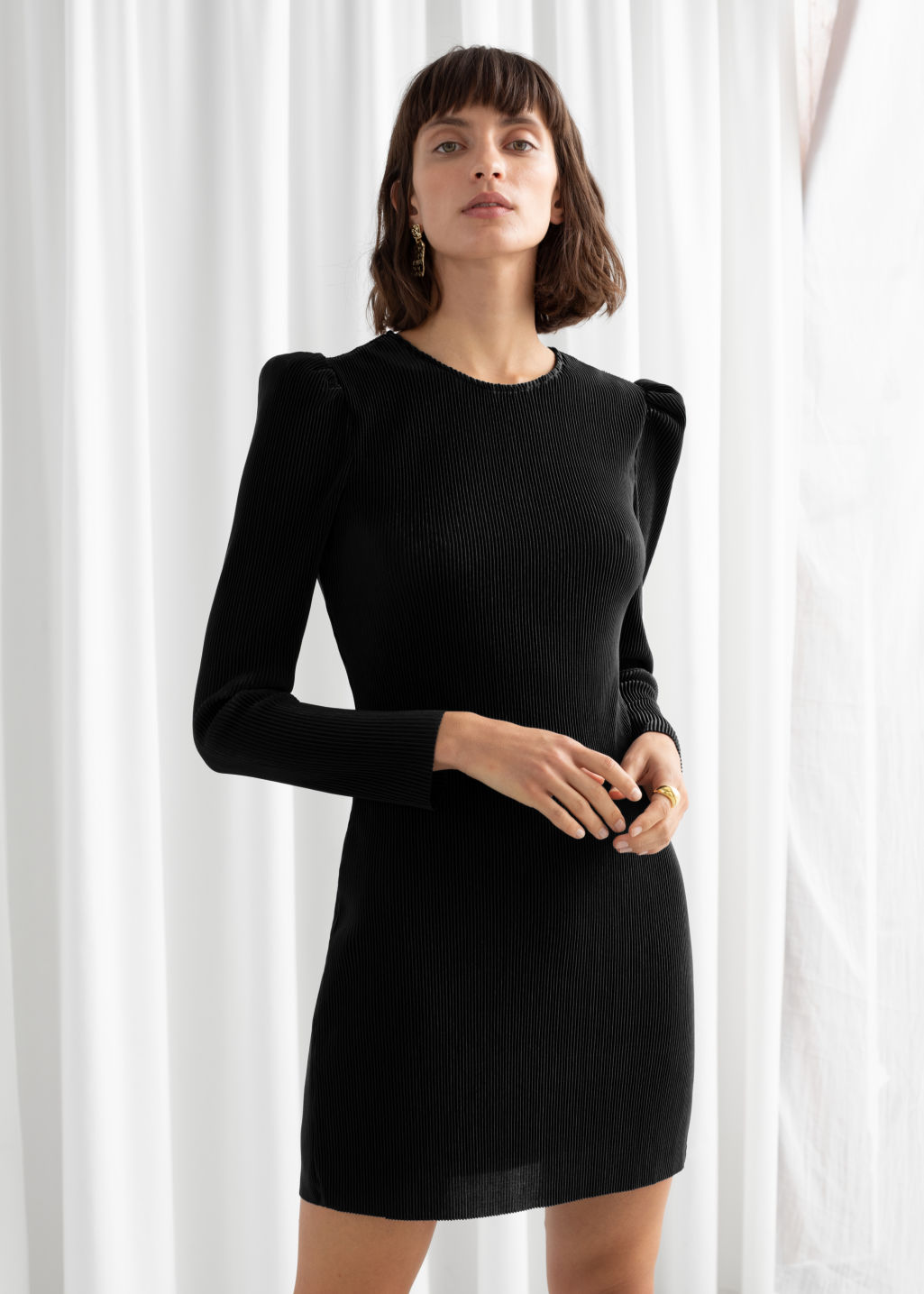 Model front image of Stories plissé pleated mini dress in black