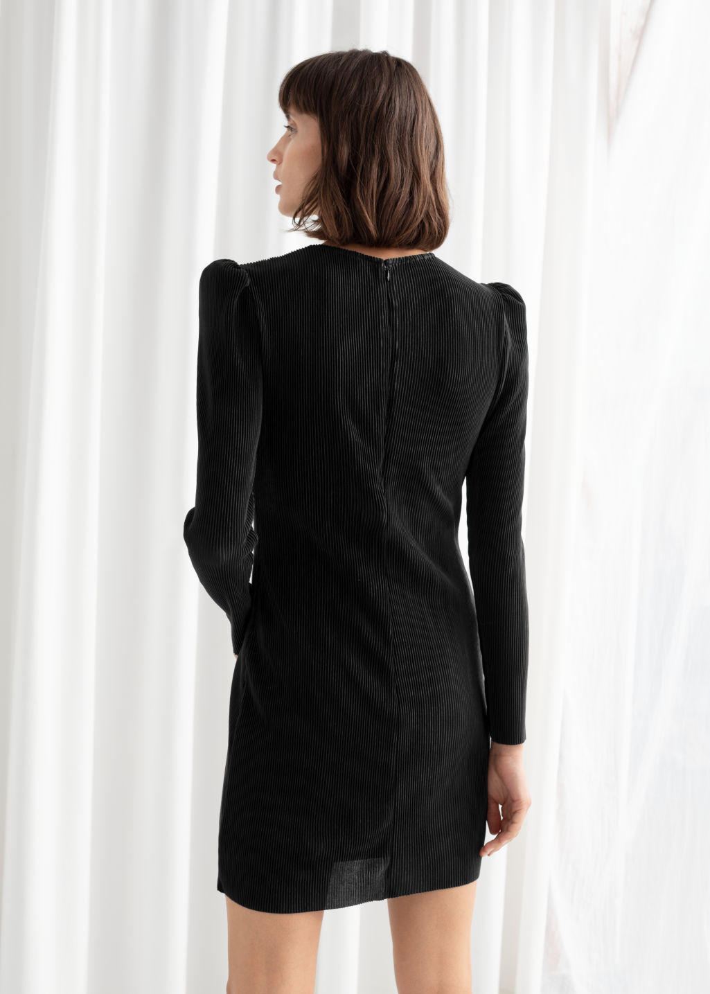 Model back image of Stories plissé pleated mini dress in black