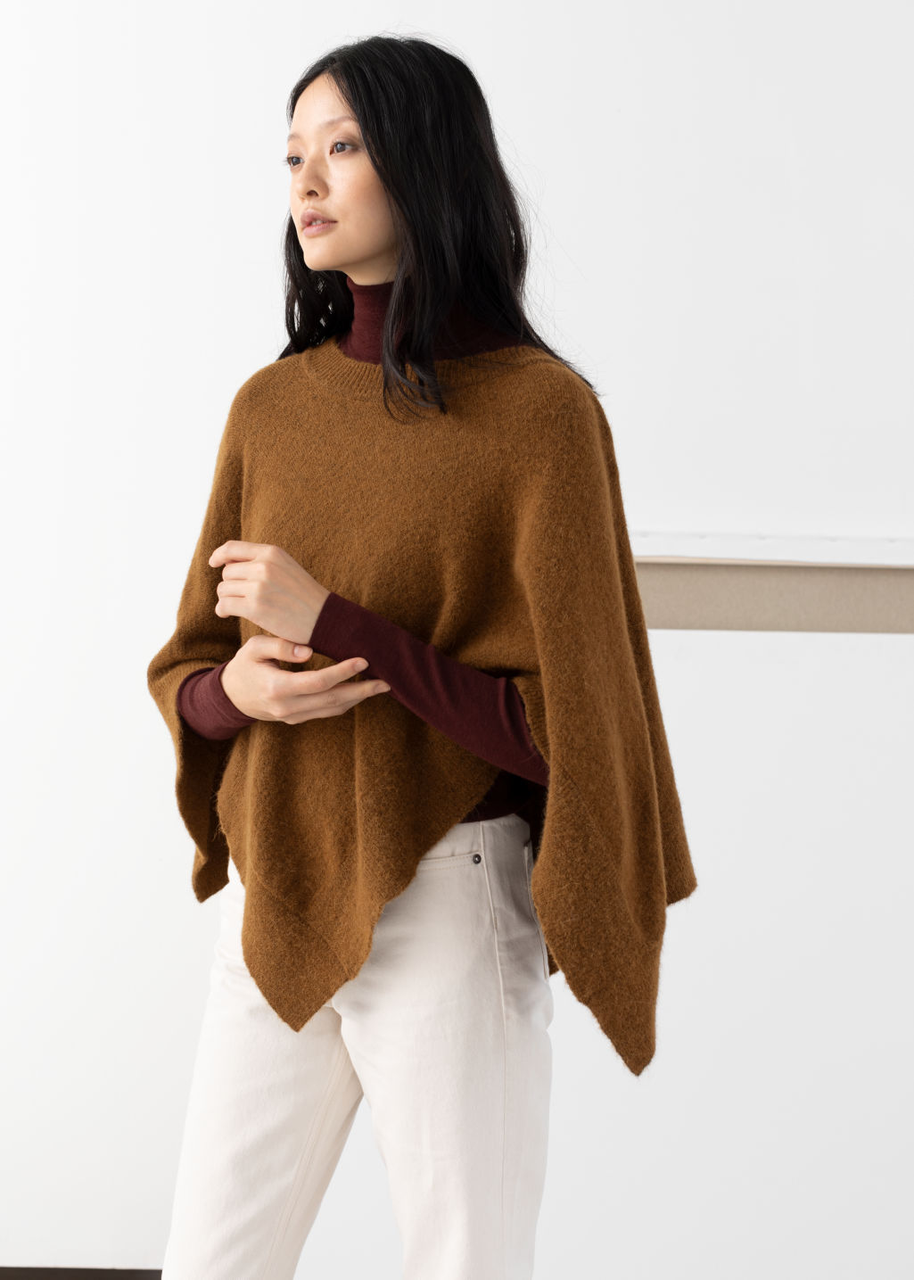 Model front image of Stories diamond wool blend poncho in beige