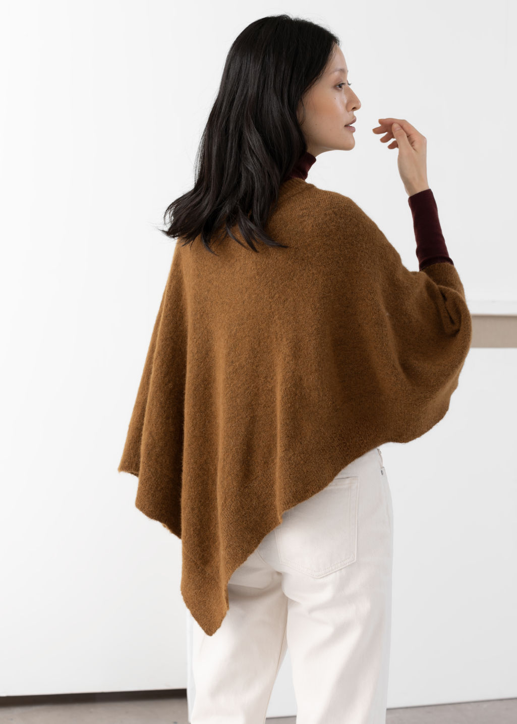 Model back image of Stories diamond wool blend poncho in beige