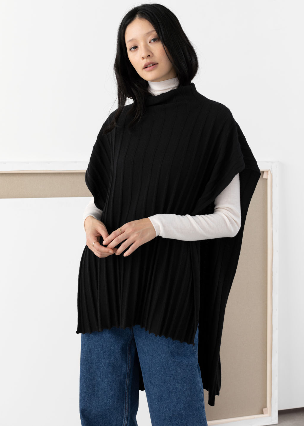 Model front image of Stories merino wool blend poncho in black