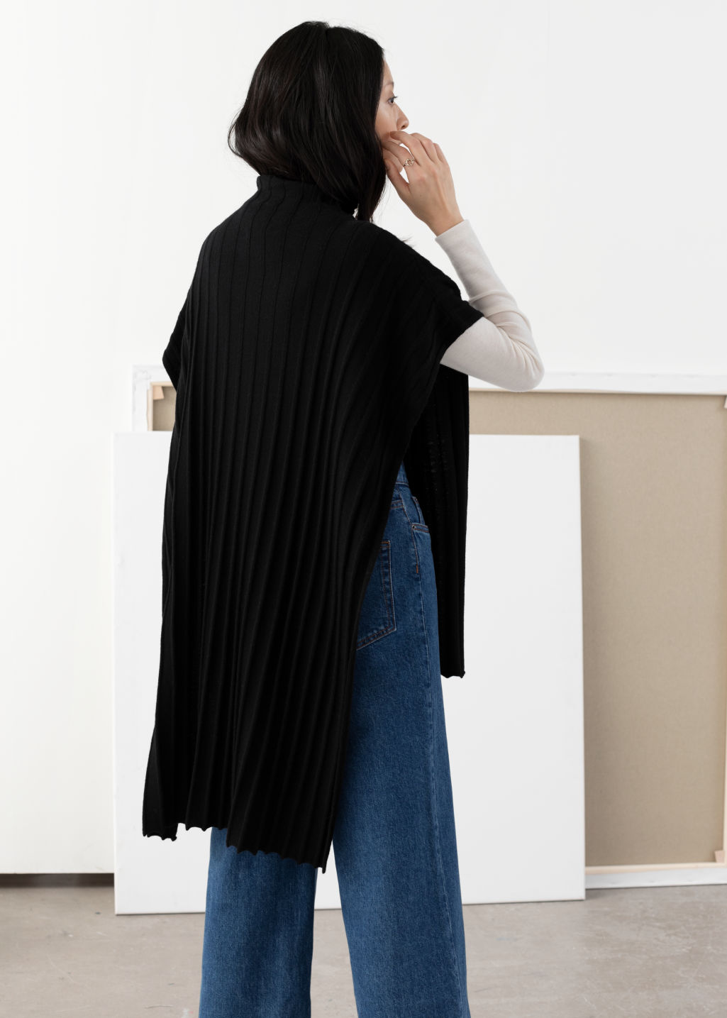 Model back image of Stories merino wool blend poncho in black