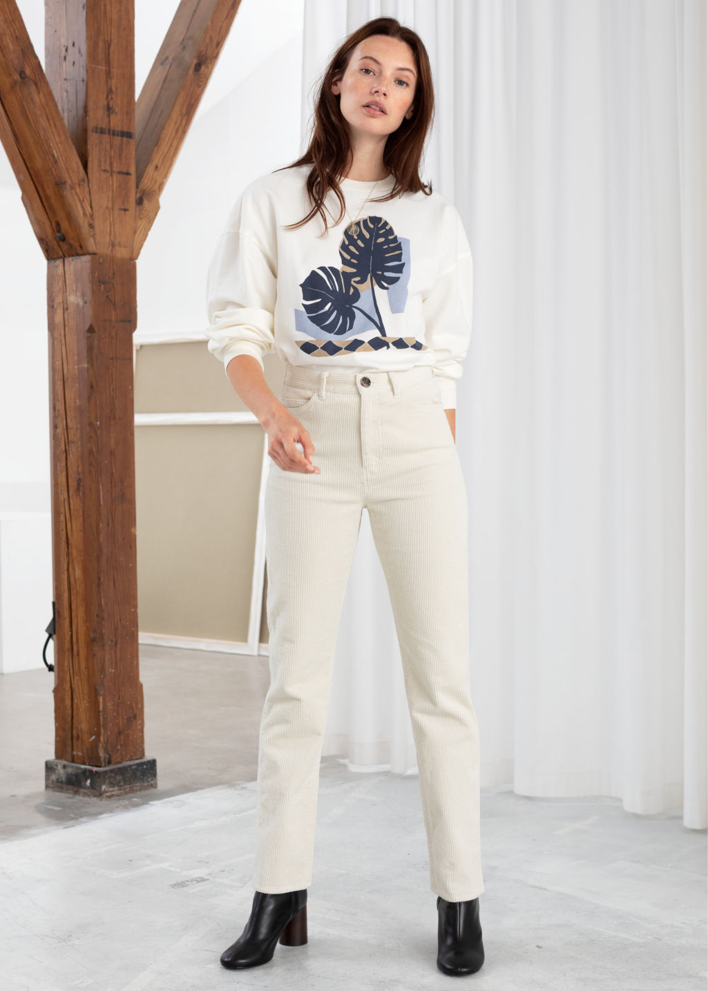 Model front image of Stories high rise tapered corduroy trousers in white