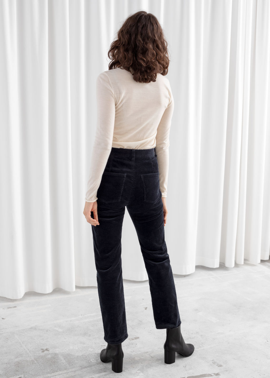 Model back image of Stories high rise tapered corduroy trousers in blue