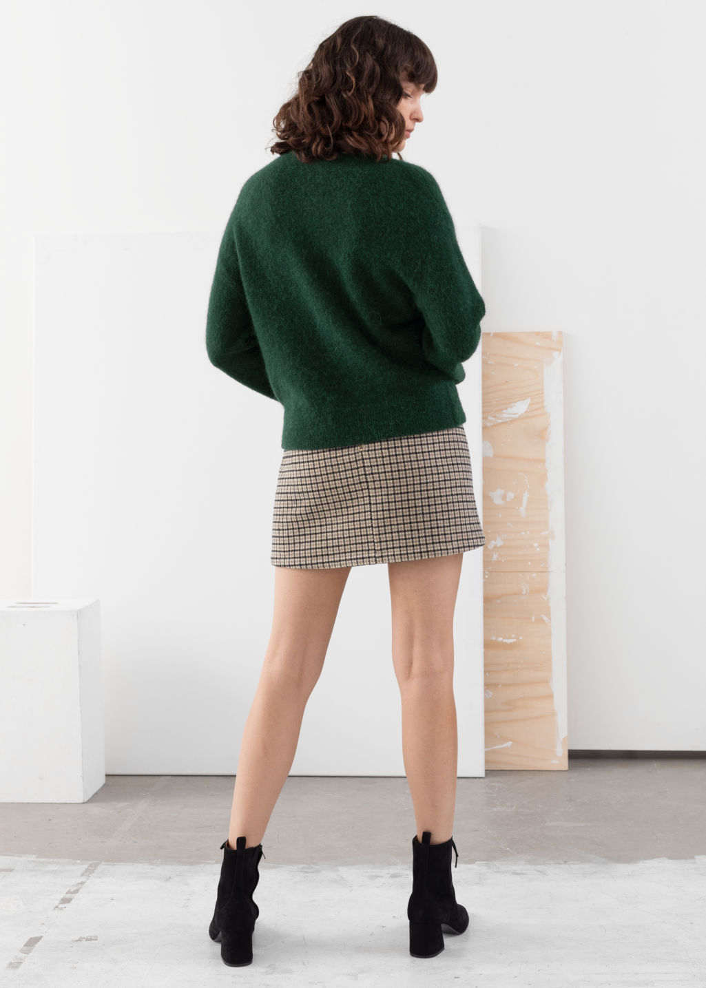 Model back image of Stories houndstooth wool blend mini skirt in beige