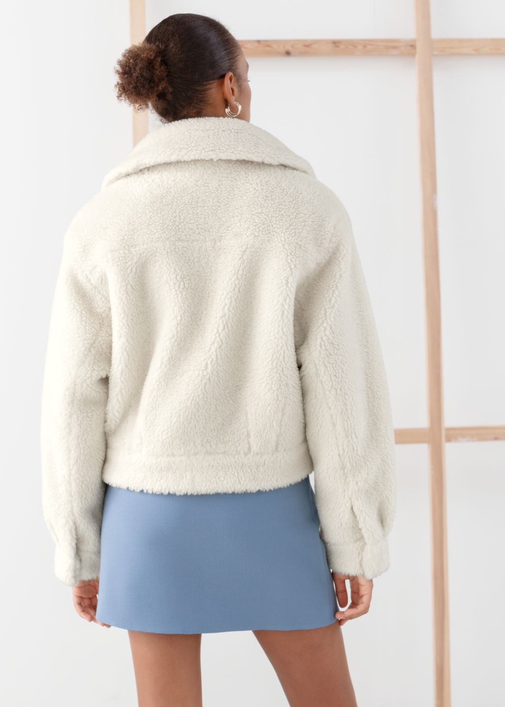 Model back image of Stories faux shearling boxy utility jacket in white