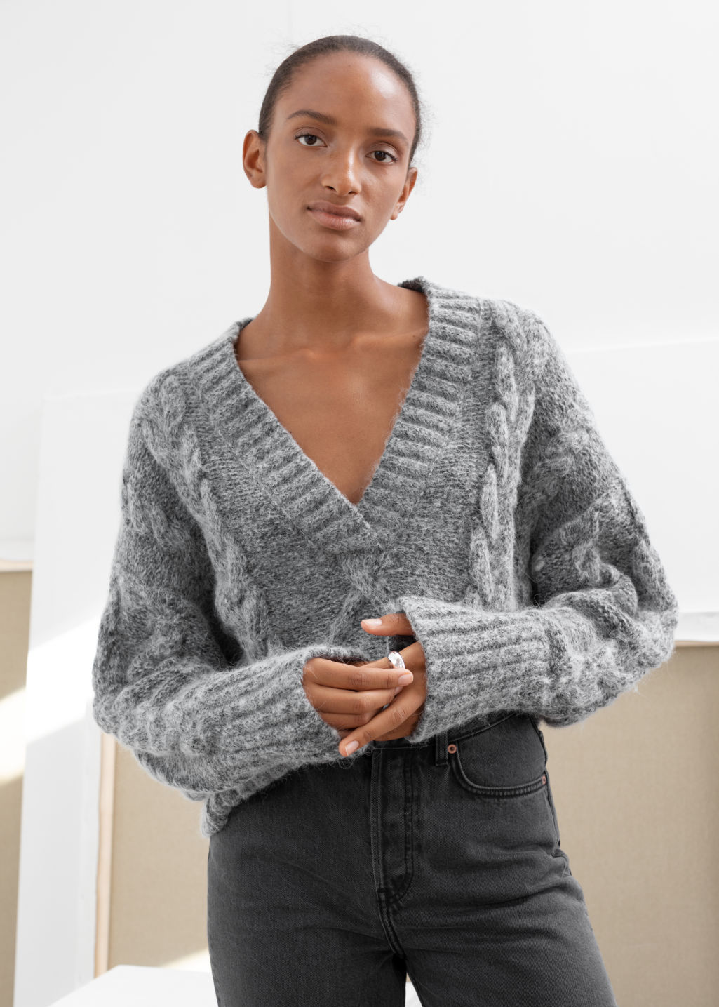 Model front image of Stories oversized cable knit sweater in grey