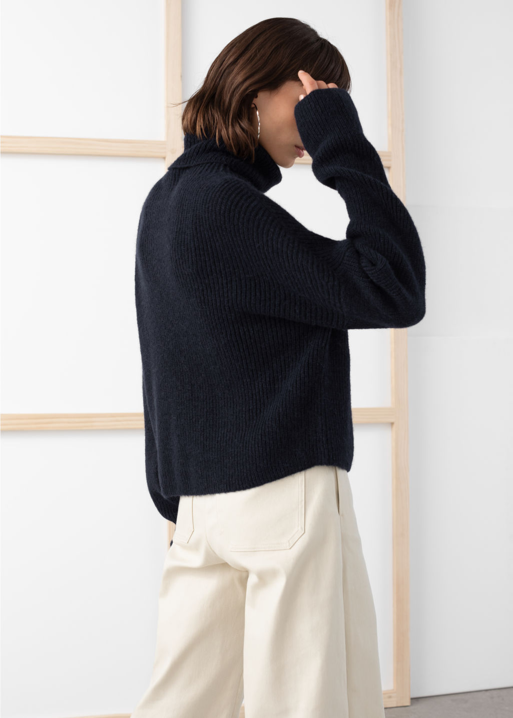 Model back image of Stories slouchy ribbed knit turtleneck in blue