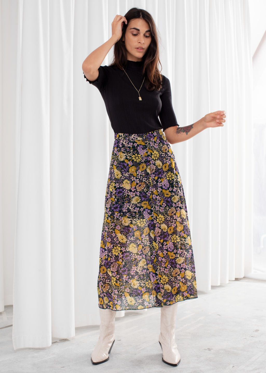 Model front image of Stories floral button up midi skirt in green