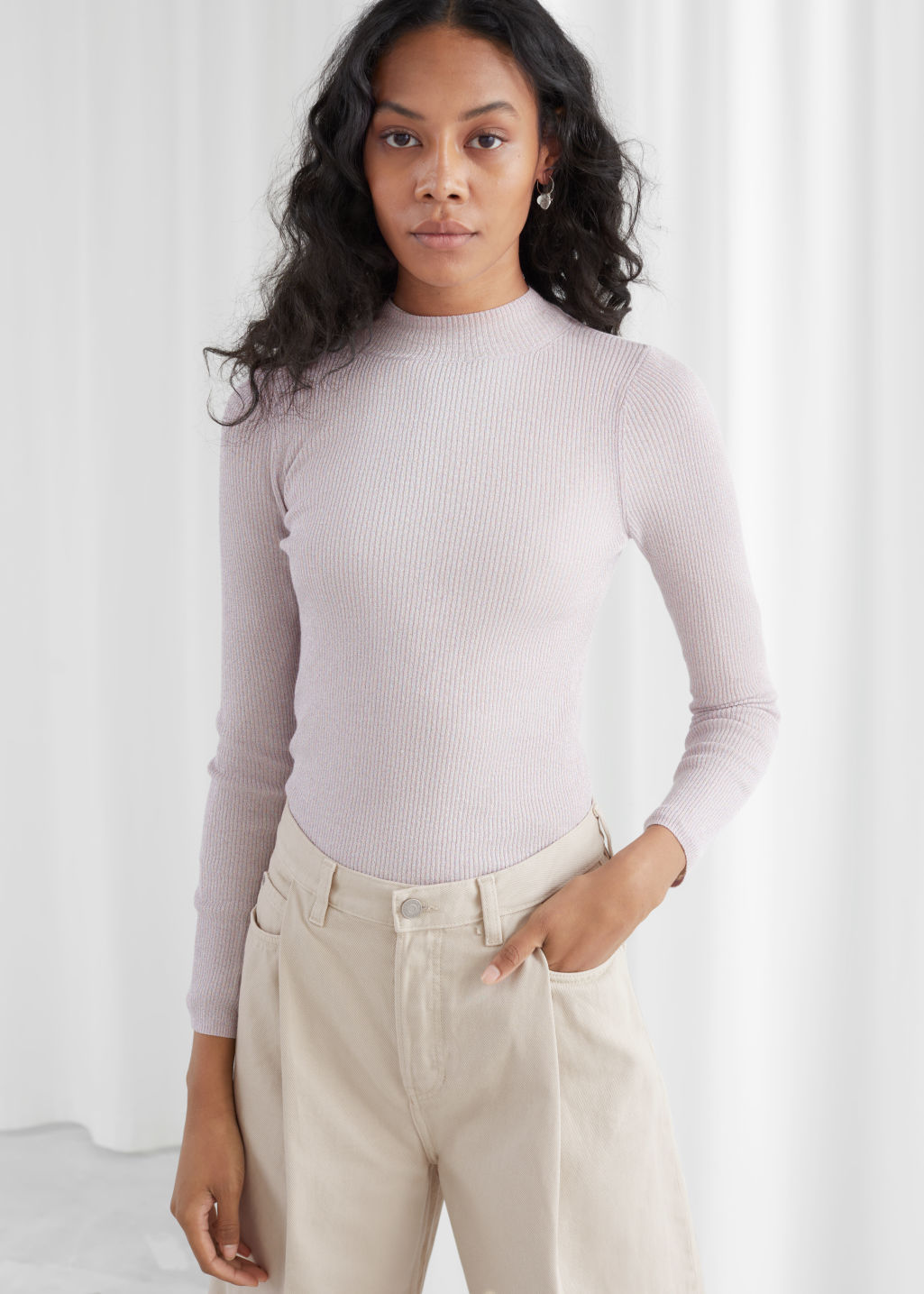 Model front image of Stories wool blend mock neck sweater in purple