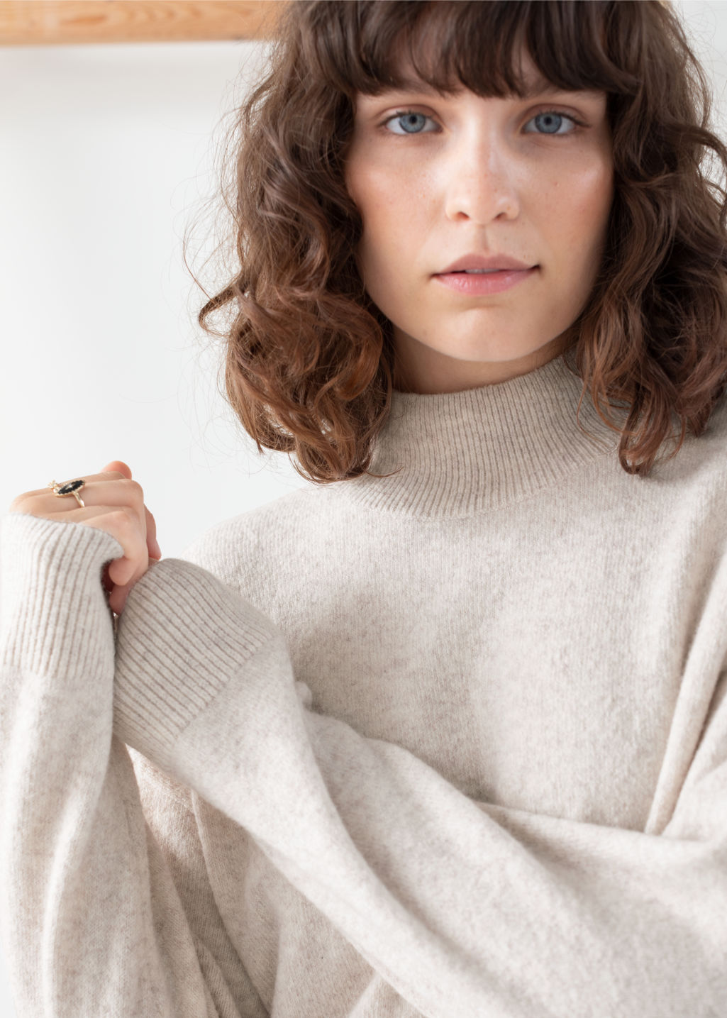 Model front image of Stories relaxed turtleneck sweater in beige