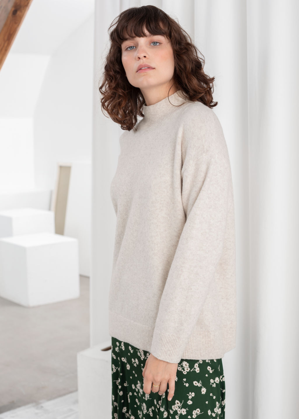 Model back image of Stories relaxed turtleneck sweater in beige