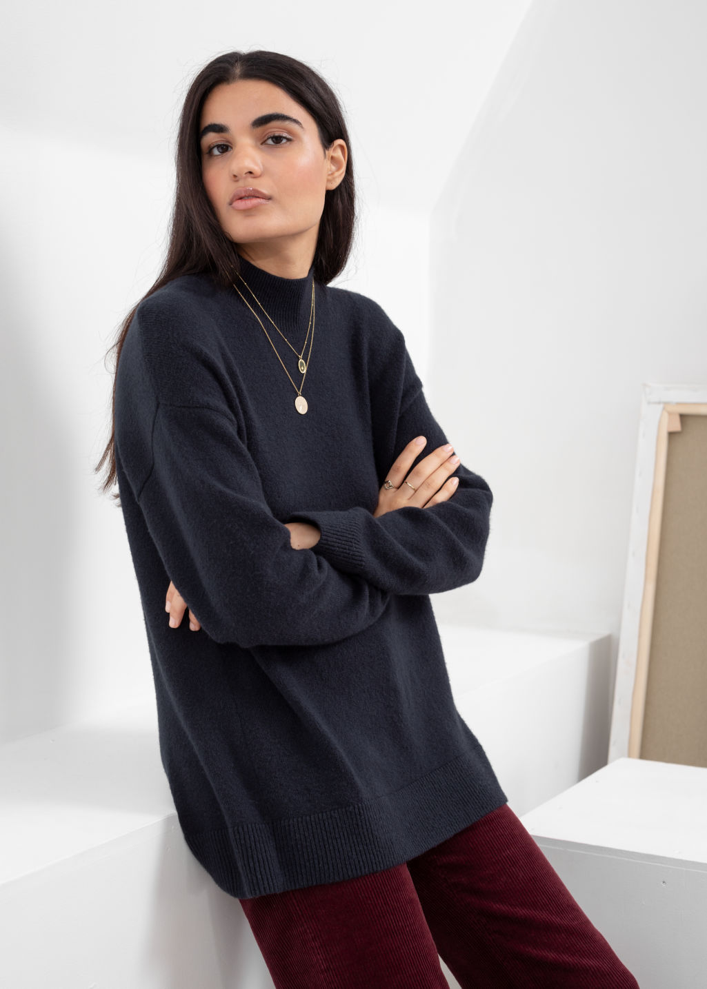 Model front image of Stories relaxed turtleneck sweater in blue