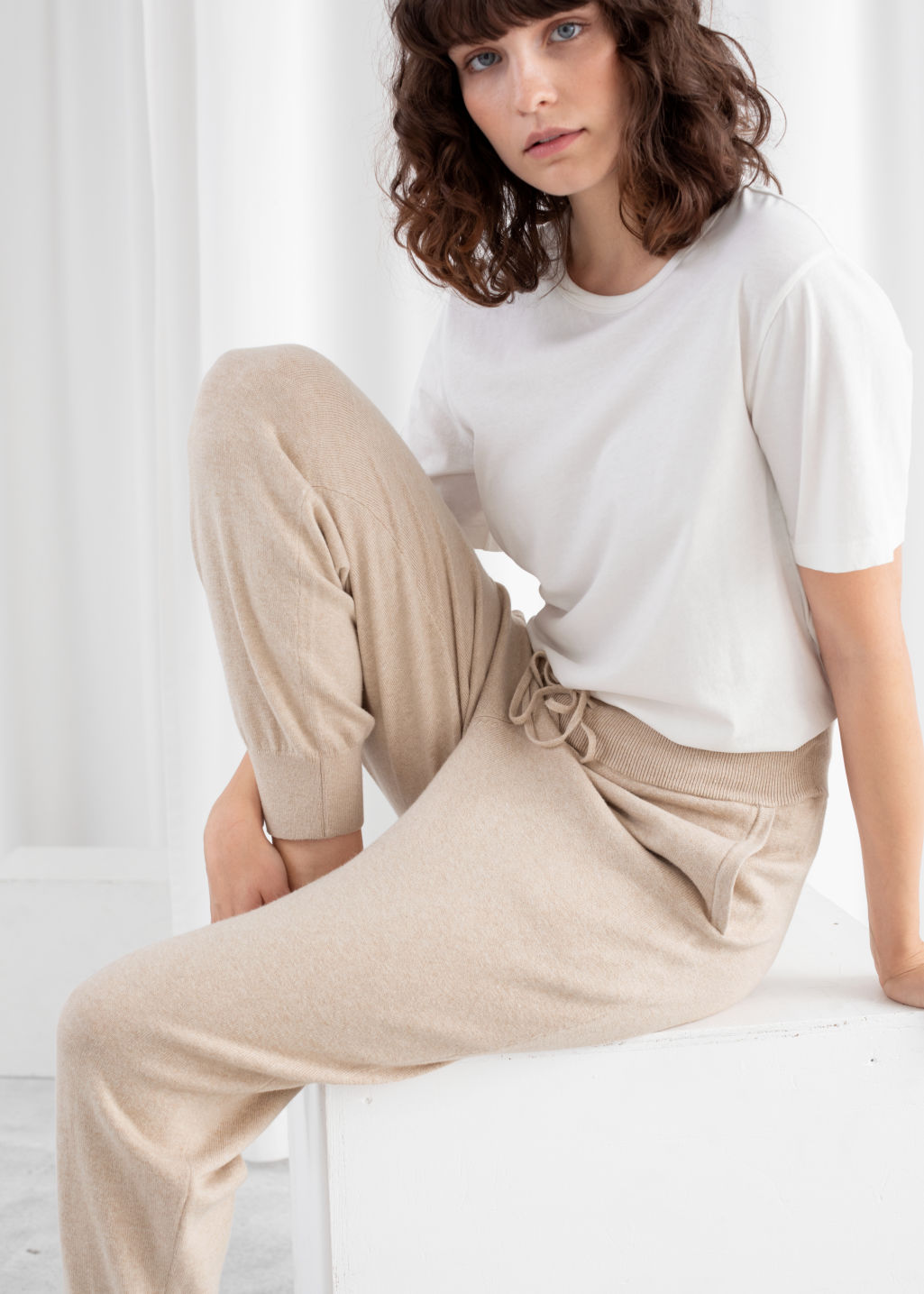 Model front image of Stories cashmere blend jogger trousers in beige