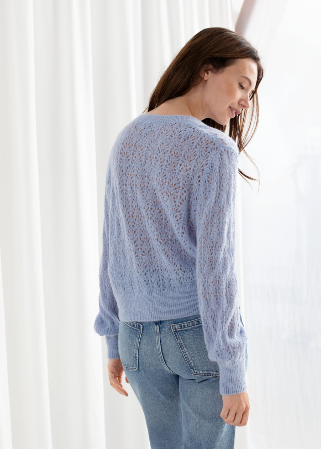 Model front image of Stories puff sleeved eyelet knit cardigan in purple