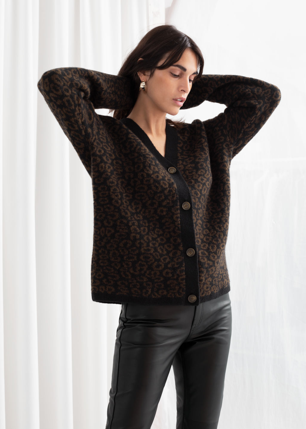 Model front image of Stories leo jacquard wool blend cardigan in black