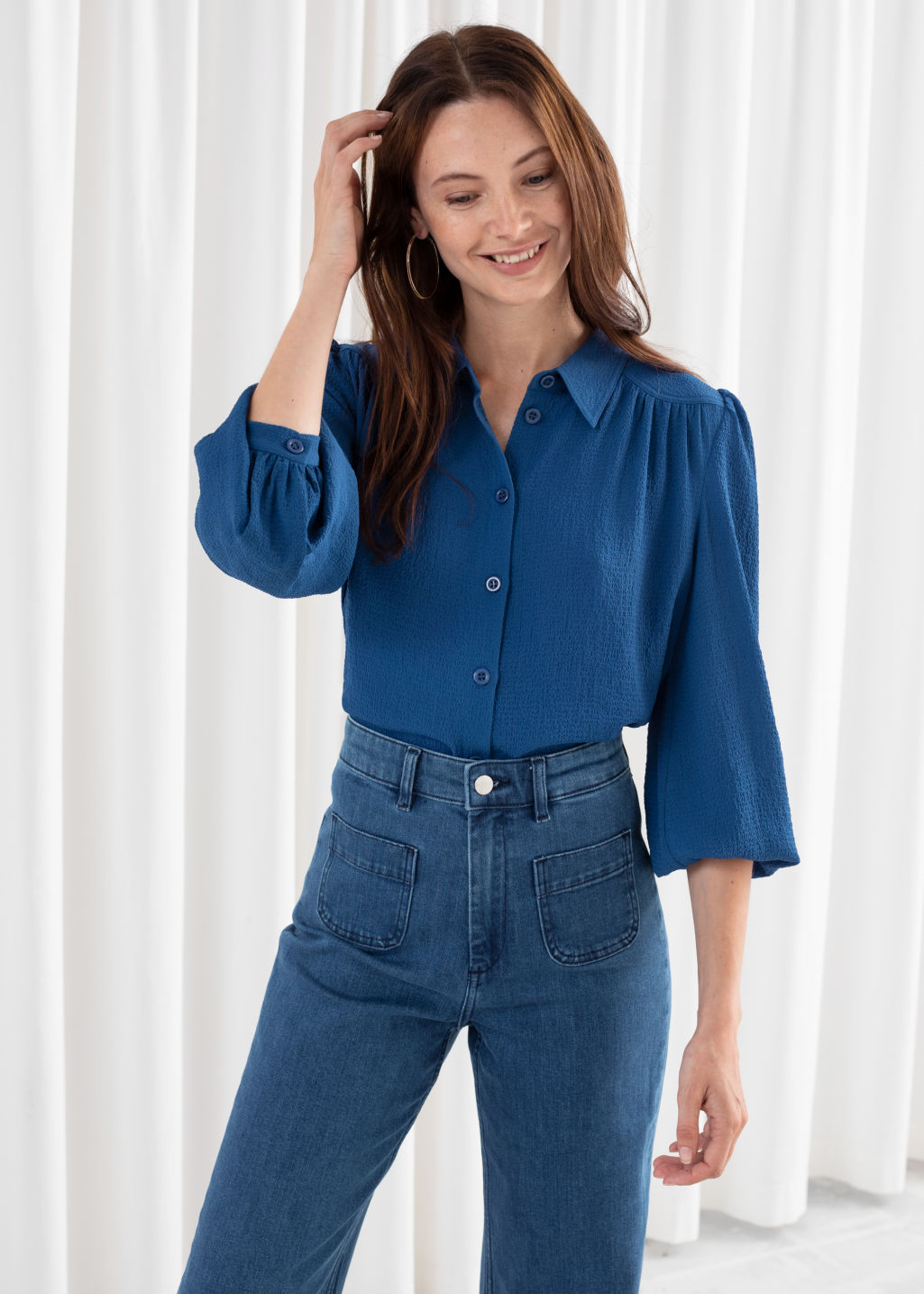 Model front image of Stories gathered crepe button down blouse in blue