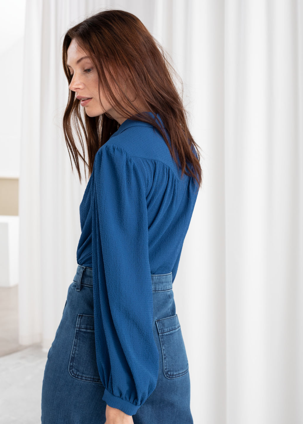 Model back image of Stories gathered crepe button down blouse in blue
