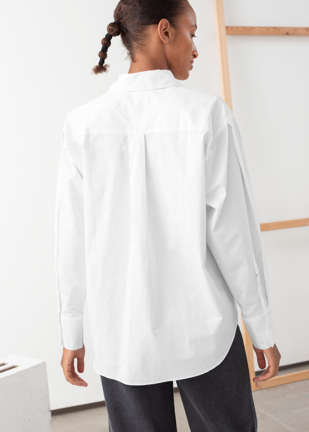 Model back image of Stories pleated shoulder cotton shirt in white