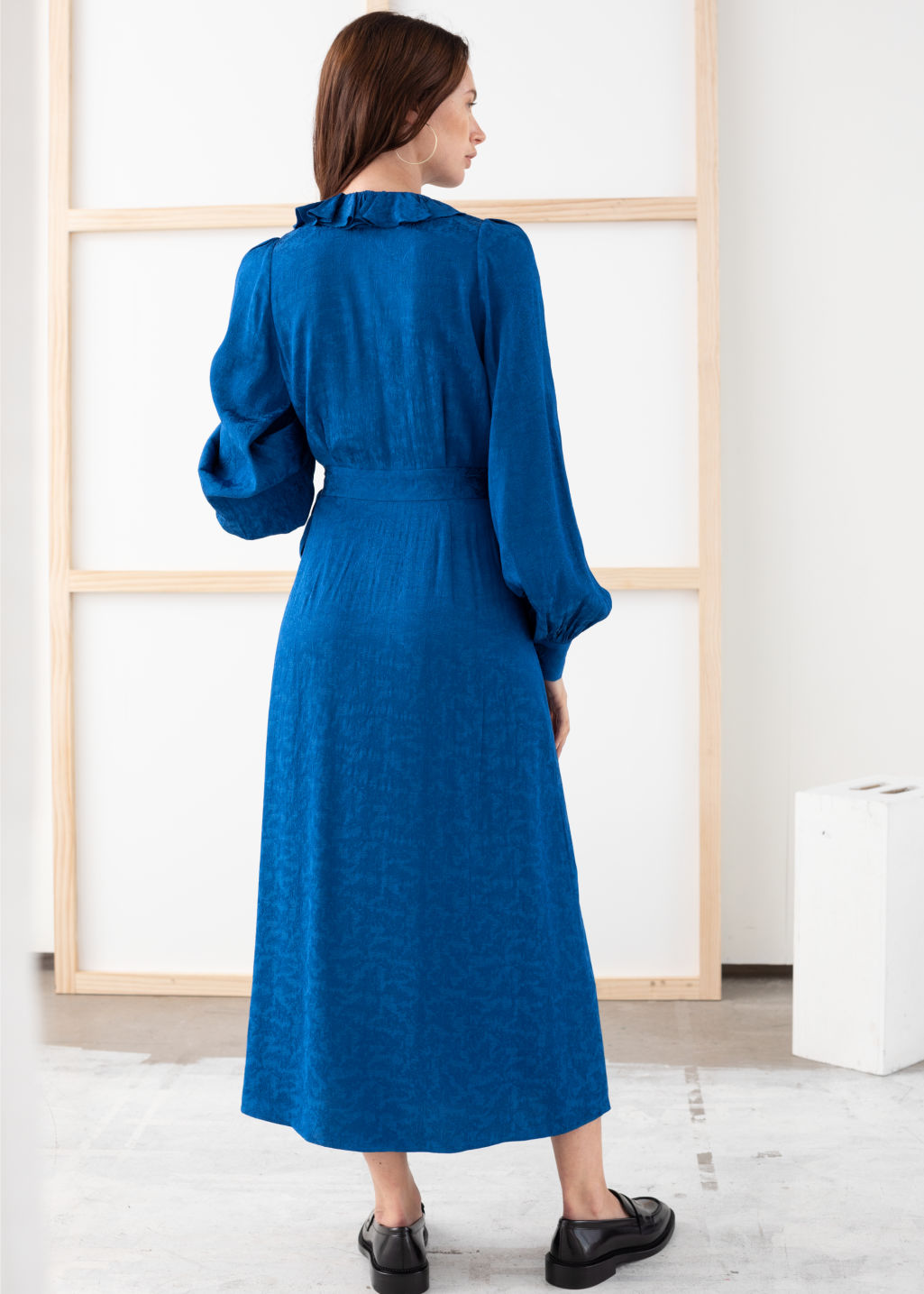 Model back image of Stories ruffled jacquard midi wrap dress in blue