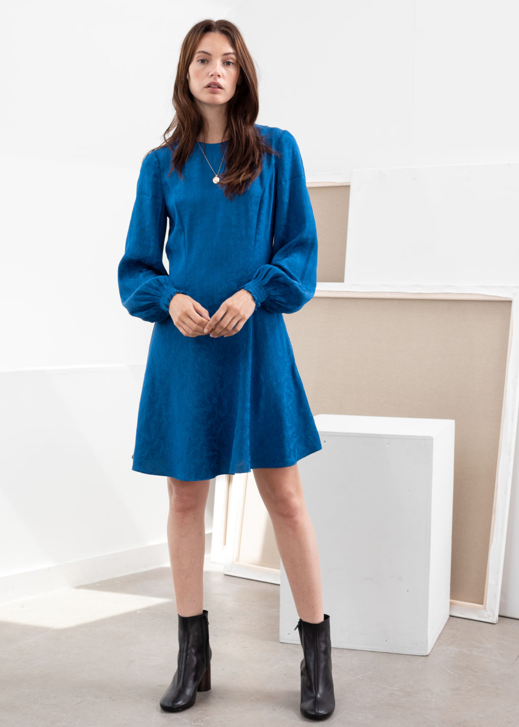 Model front image of Stories jacquard puff sleeve mini dress in blue