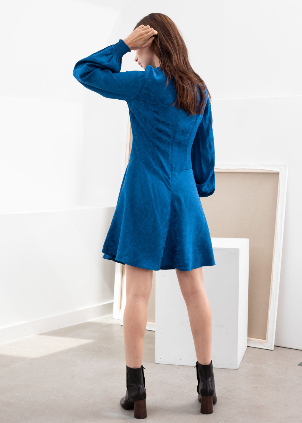 Model back image of Stories jacquard puff sleeve mini dress in blue